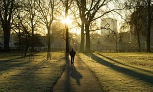 A man walks through Green Park