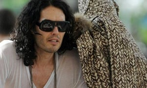 Katy Perry (under a coat) and Russell Brand