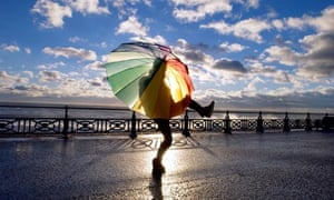 Woman with an umbrella on Hove promenade