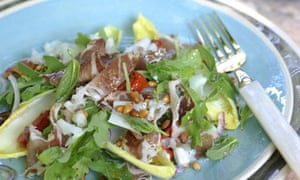 An Italian salad with rocket and coppa di parma finished with pinenuts