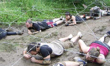Crawling under barbed wire during Tough Guy: Nettle Warrior