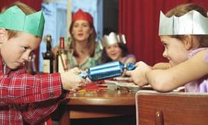 Children pulling a Christmas cracker