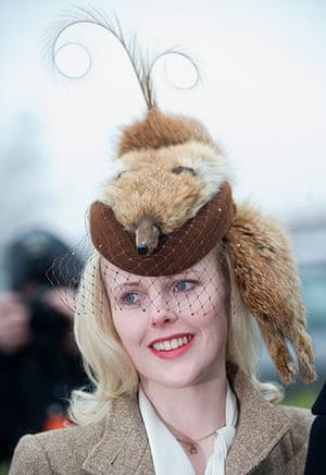 Cheltenham ladies day: A lady in a fox skin hat at Cheltenham Festival