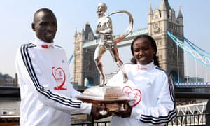 Running the show ... Emmanuel Mutai and Mary Keitany with the London Marathon trophy.