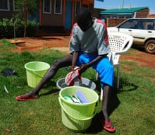 Emmanuel Mutai cleans his running shoes.