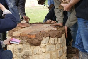 Cob is used to fill in the edges around the firebricks