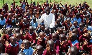 Isaac Arusei with the children from Arusei Junior Academy