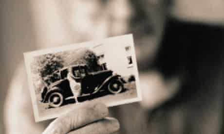 Man Holding a Vintage Photograph