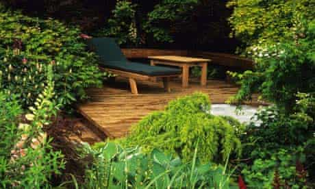 A garden with a raised decking area