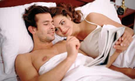 Couple doing the crosswordd in bed
