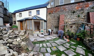 A stone patio being built