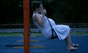 Pregnant woman on a swing