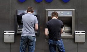 Men at RBS ATMs