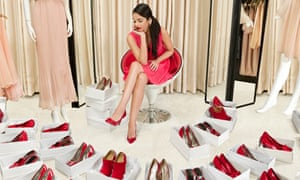 Woman struggling to choose a new pair of shoes