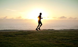 A silhouette of a jogger