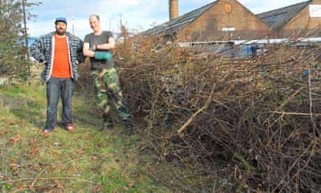 Building a dead hedge at the Glengall Wharf Garden in south London