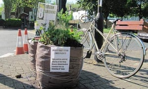 Planted sack gardens on the streets of Mildmay in Islington