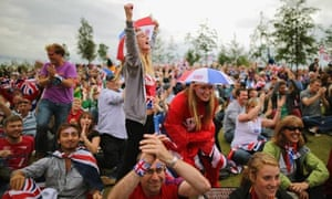 Fans watch the big screen in the Olympic Park