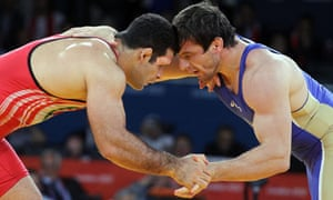 Ghasem Gholamreza Rezaei, in red, on his way to the gold in the men's 96kg Greco-Roman wrestling