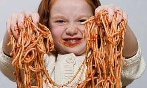 Girl holding spaghetti