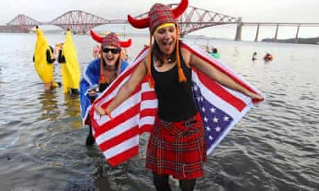 Cold turkey … swimmers in fancy dress participate in the New Year's Day Loony Dook swim in the Firth