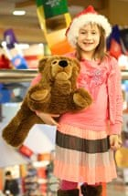 Maddy with her new best friend, a Steiff bear