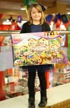 Isabelle with her Lego Friends house