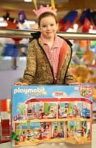 Lily with her Playmobil hotel