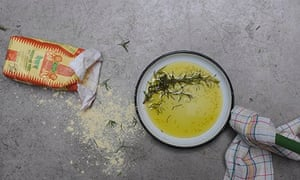 Ruby bakes rosemary…  cook the olive oil, garlic and the leaves from two rosemary sprigs