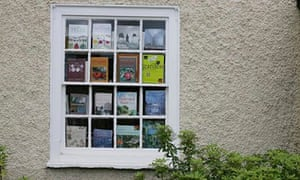 Gardening books on display in the window of a bookshop in Hay-On-Wye