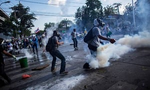Riot police fire tear gas at protesters in Bangkok, Thailand