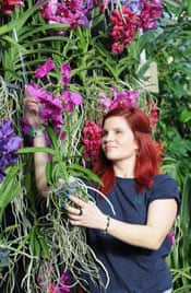 Elisa Biondi, horticulturalist in the Princess of Wales conservatory, tends vanda orchids