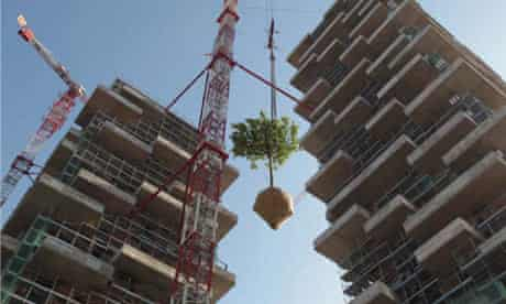 Trees being installed onto the Bosco Verticale skyscraper in Milan