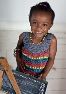 Girl wearing rainbow bright dress