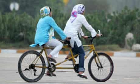 Two women cycling