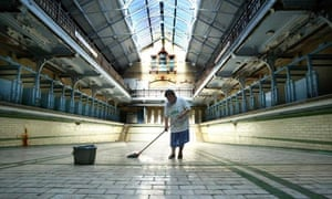 A cleaner mops Manchester's disused Victoria Baths