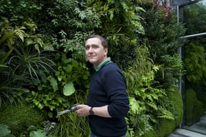 Living wall: Garden designer Daniel Bell with the living wall