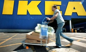 Shopper pushes a trolley at Ikea