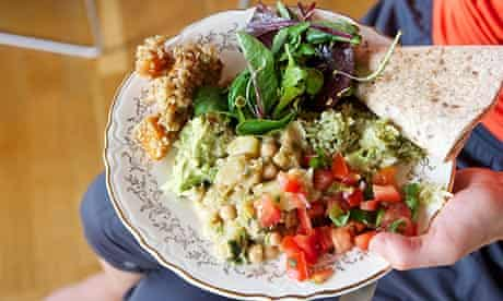The Veggie Runners mother Dr Jayne Rodgers and her daughter Bibi Rodgers have brunch with friends at Jayne's appartment after the Leeds 10K run.