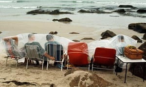 Holidaymakers on a beach in 1970