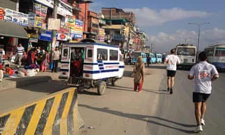 Running with buses in the Kathmandu marathon