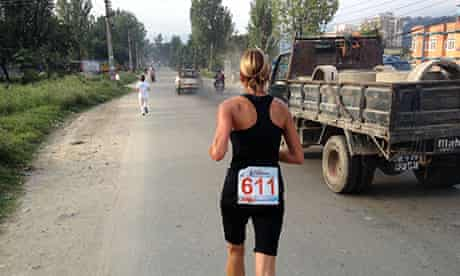 Running with trucks in the Kathmandu marathon
