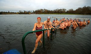 Serpentine Swimming Club members emerge from their traditional Christmas Day dip in Hyde Park, Londo