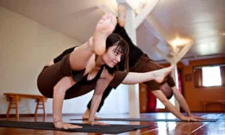 Two people practising yoga