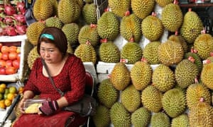 A woman selling durians