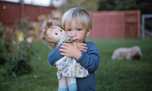 A boy with his sister's doll.