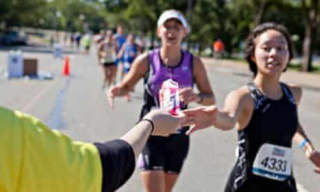Marathon runner reaching for an energy gel packet