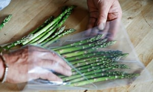 Putting the asparagus in the bag