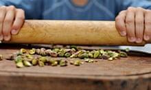 Back to basics salads: crushing pistachio nuts