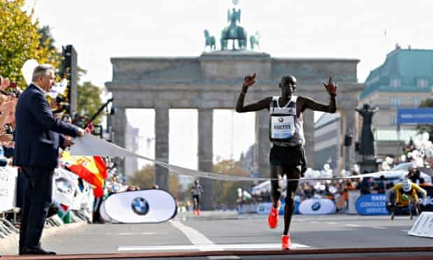 Dennis Kimetto of Kenya crosses the finish line in new world record time